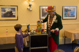 Cosmo entertains the children in the Verandah Room at Langstone Cliff Hotel