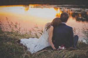 newlyweds watching sunset